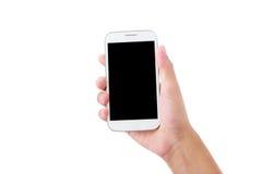 Smartphone femminile della tenuta della mano isolato su bianco Fotografia Stock Libera da Diritti