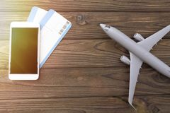 Smartphone, flight tickets. airport. Smartphone, flight tickets. airplane on a wooden background. journey. tourism. airport Stock Photos