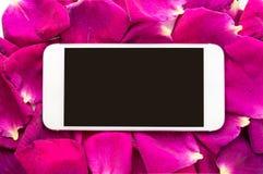 Smartphone on floral framework Stock Photography