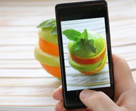 Smartphone food photo - slices apple and orange Royalty Free Stock Photos