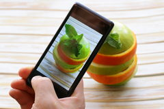 Smartphone food photo - slices apple and orange Stock Photography