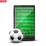 Smartphone with football ball and field on the Stock Images