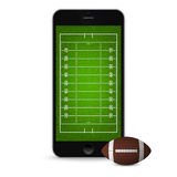 Smartphone with football and field on the screen. Royalty Free Stock Image