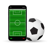 Smartphone with a football field and soccer football. A smartphone with a football field and soccer football Royalty Free Stock Photo