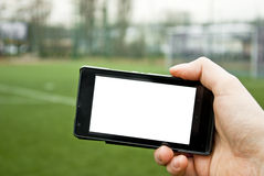 Smartphone and football pitch Royalty Free Stock Photo