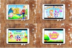 Smartphone games Candy Crush Saga , Cookie Jam , Candy Blast Mania , Farm Heroes Saga. Logos of smartphone games Candy Crush Saga , Cookie Jam , Candy Blast Royalty Free Stock Photography