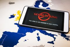 Smartphone with Geo-blocking over EU map. European Union Digital single market and regulation against Geo-blocking and geographically-based restrictions stock photo