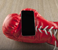 Smartphone in glove Stock Photos
