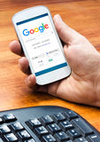 Smartphone with a Google Web Search on the Screen Royalty Free Stock Photography