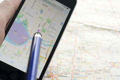 Smartphone with GPS navigator on map Royalty Free Stock Photo