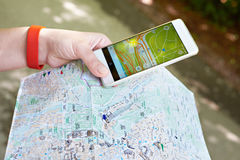 Smartphone with GPS navigator and map in hand stock photo