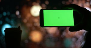 Smartphone with Green Screen city night bokeh background stock footage