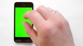 Smartphone with green screen, hand clicks. And smacks stock video footage