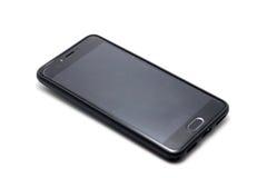 Smartphone gris sur un fond blanc Photo libre de droits