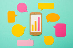 Smartphone with growth chart and speech bubbles Royalty Free Stock Photography