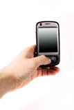 Smartphone in hand. Isolated black smartphone on white background, cell in hand Stock Image