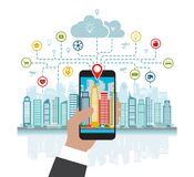 Smartphone in hand helps to focus in a smart city with advanced smart services, and augmented reality, social networking Royalty Free Stock Photo