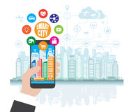 Smartphone in hand helps to focus in a smart city with advanced smart services, and augmented reality, social networking. The concept of smart city, social Stock Photo