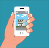 Smartphone in hand with house picture Vector Stock Photos