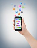 Smartphone, hand & icons Royalty Free Stock Images
