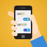 Smartphone in hand. Messages with emoji. Part one. Stock Photography