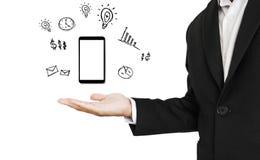 Smartphone an Hand mit Kopienraum, mit nützlichem von Smartphonezeichnungen, lokalisiert auf weißem Hintergrund Lizenzfreies Stockbild