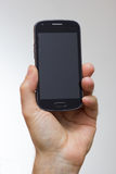 Smartphone in a hand outstretched Stock Photo
