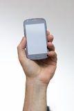Smartphone in a hand outstretched Royalty Free Stock Photo