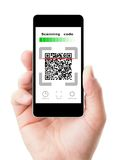 Smartphone in hand scanning code royalty free stock photo