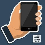 Smartphone in hand. Vector. Stock Photos