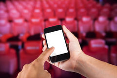 Smartphone on hand and white screen with blurry background Royalty Free Stock Image