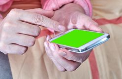 Smartphone in hands Stock Photography