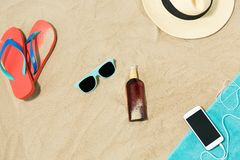 Smartphone, hat, flip flops and shades on beach stock photos