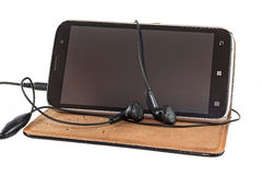 Smartphone with headphones Royalty Free Stock Photo