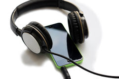 Smartphone with headphones and jack plugged in Royalty Free Stock Image