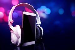 Smartphone with headphones. Modern equipment smartphone with headphones Stock Photography