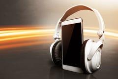 Smartphone with headphones. Modern equipment smartphone with headphones Stock Photo