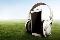 Smartphone with headphones. Modern equipment smartphone with headphones Royalty Free Stock Photo