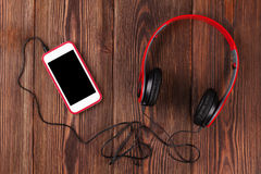 Smartphone and headphones Stock Image