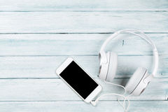Smartphone and headphones Royalty Free Stock Photography