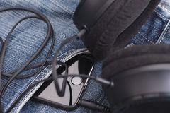 Smartphone with headphones Stock Photo