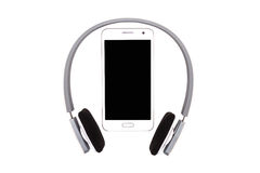 Smartphone with headphones on white background Stock Photography