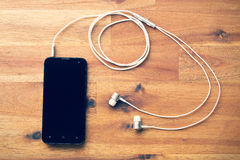 Smartphone with headphones Royalty Free Stock Image