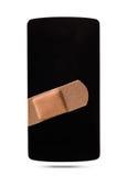 Smartphone healed with bandaid Stock Photos