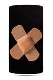 Smartphone healed with bandaid Royalty Free Stock Photo
