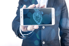 Smartphone And Heart Stock Photography