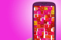Smartphone hearts Stock Image