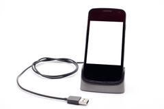 Smartphone-het laden Stock Foto