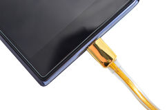 Smartphone with high speed gold usb cable Royalty Free Stock Photography