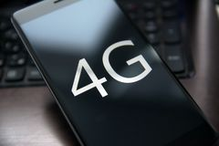 4g phone. Smartphone with high-speed Internet 4g close-up with shallow depth of field Stock Photos